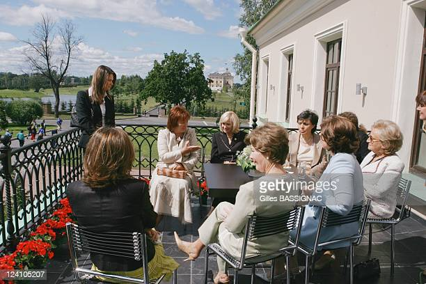 The G8 summiteers' wives have their official photograph taken in Russia on July 16 2006 Laura Bush wife of the US President Bernadette Chirac wife of...