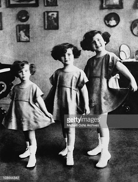 The Gabor Sisters LR Eva Gabor Zsa Zsa Gabor and Magda Gabor pose for a portrait circa 1923 in Budapest Hungary