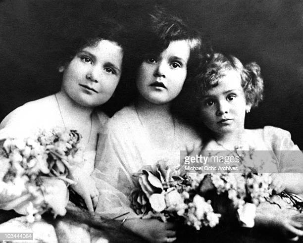 The Gabor Sisters LR Magda Gabor Zsa Zsa Gabor and Eva Gabor pose for a portrait circa 1923 in Budapest Hungary