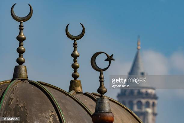 The Galata Tower with Crescent symbols,Istanbul,Turkey