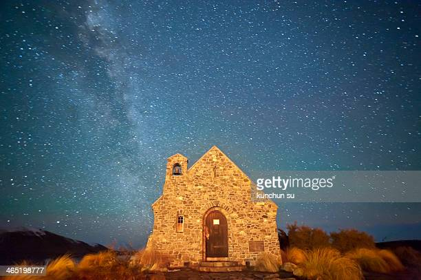 CONTENT] the galaxy across the sky in Lake Tekapo New Zealand and the Church of The Good Shepherd accompany it