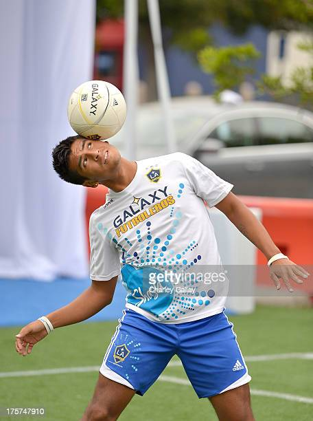 The LA Galaxy Futboleros show off their soccer skills at the grand opening celebration of the new Windows Store Only at Best Buy on August 7 2013 in...