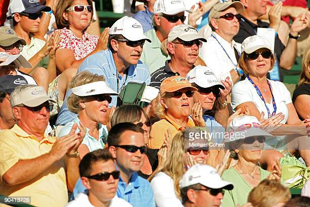 The gallery applauds a shot on the 18th green during the third round of the Deutsche Bank Championship at TPC Boston held on September 6 2009 in...