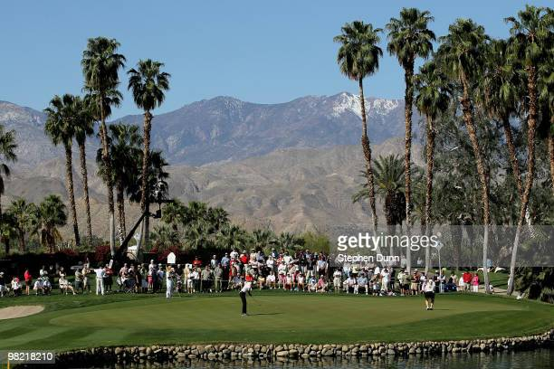 The gallery around the 14th green watches as Michelle Wie putts during the second round of the Kraft Nabisco Championship at Mission Hills Country...