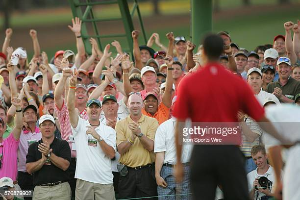 The gallery celebrates after Tiger Woods makes a birdie putt at No 18 in the first hole of a suddendeath playoff to win The Masters his fourth and...