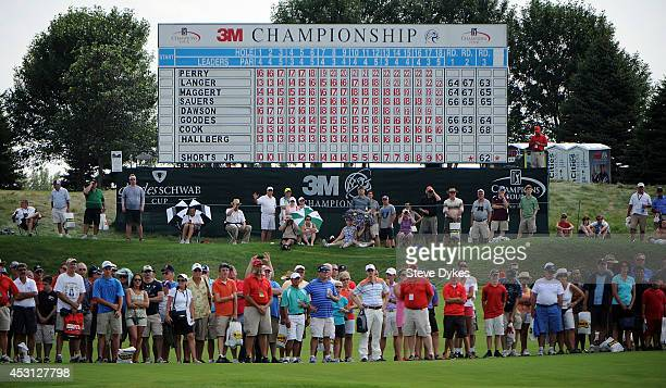The gallery closes in on the 18th green to watch Kenny Perry hit a birdie putt to win the 3M Championship at TPC Twin Cities on August 3 2014 in...