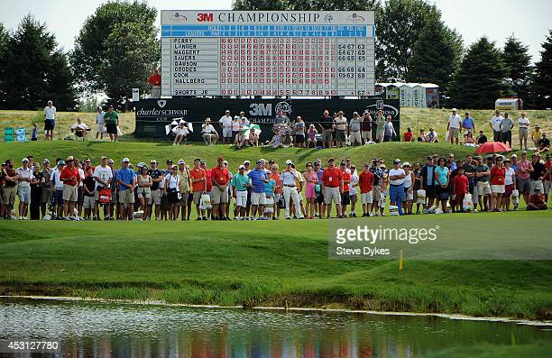 The gallery closes in on the 18th hole to watch Kenny Perry hit a birdie putt to win the 3M Championship at TPC Twin Cities on August 3 2014 in...
