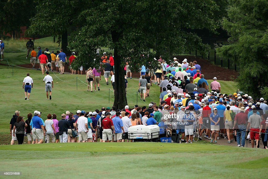 The gallery following Phil Mickelson's group heads down the first fairway during the continuation of the second round of the FedEx St. Jude Classic at the TPC Southwind on June 7, 2014 in Memphis, Tennessee.