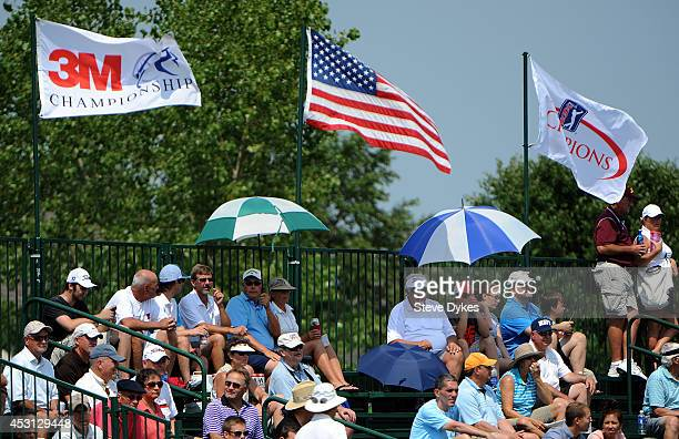 The gallery tries to find some shade under umbrellas on the 17th hole during the final round of the 3M Championship at TPC Twin Cities on August 3...