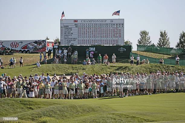 The gallery walks up the 18th fairway during the third and final round of the 3M Championship held at TPC Twin Cities in Blaine Minnesota on August 6...