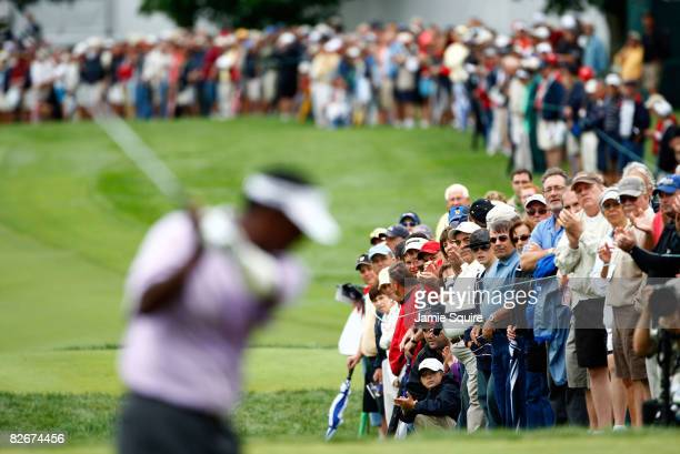 The gallery watches Vijay Singh of Fiji on the 10th hole during the weatherdelayed first round of the BMW Championship on September 5 2008 at...
