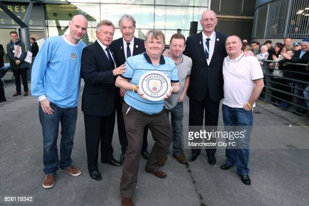 The Galway branch of the Manchester City supporters club recieve an award before the game