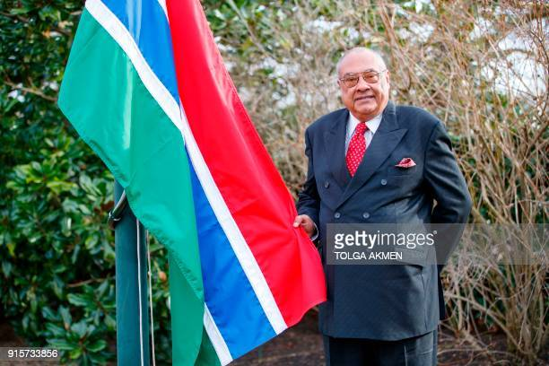 The Gambian high commissioner Francis Blain poses with The Gambian flag during a ceremony to officially welcome The Gambia back into the Commonwealth...
