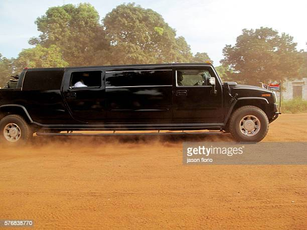 The Gambia's President Jammeh in his Hummer passing a group of women and children in The Gambian village of Killin Jamme's highspeed convoys have...