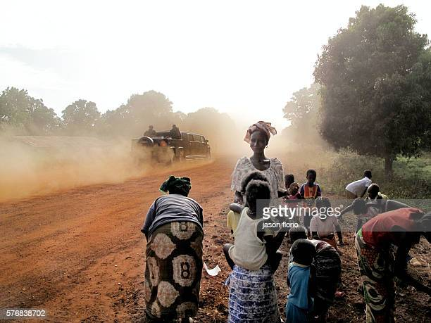 The Gambia's President Jammeh's Hummer passing a group of women and children in The Gambian village of Killin Jammeh's high speed convoys have...