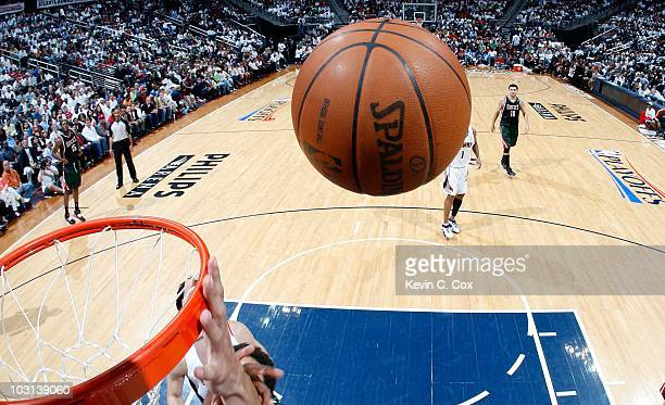 The game ball bounces off the rim during the game between the Atlanta Hawks and the Milwaukee Bucks at Philips Arena on April 20 2010 in Atlanta...