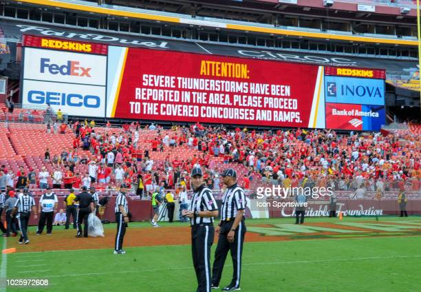 The game between the Texas Longhorns and the Maryland Terrapins is halted in the fourth quarter as weather approaches on September 1 at FedEx Field...