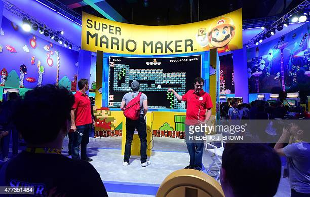 The game is explained as a man plays Super Mario maker on a big screen at E3 the Electronic Entertainment Expo an annual video game conference and...