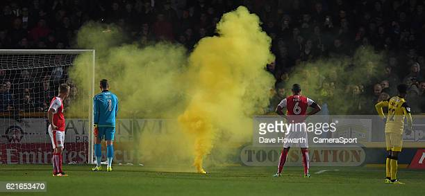 The game is stopped for a flare on the pitch during the The Emirates FA Cup First Round match between Southport and Fleetwood Town at the Merseyrail...