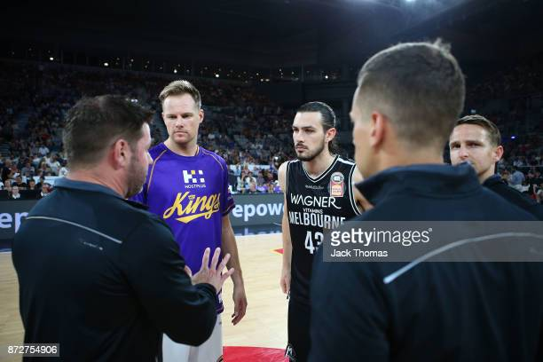 The game officials chat to Brad Newley of the Sydney Kings and Chris Goulding of Melbourne United prior to the round six NBL match between Melbourne...