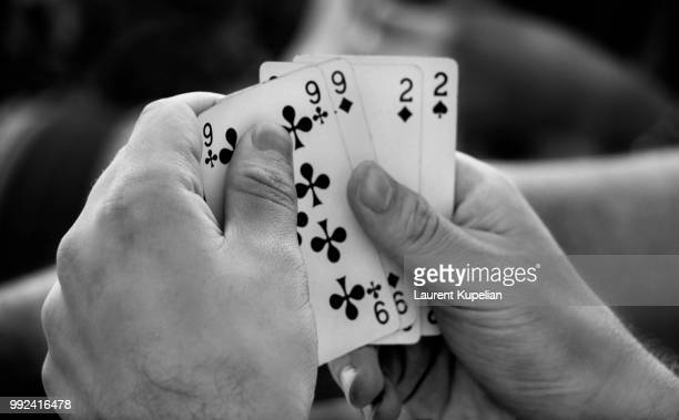 the game - hand of cards stock photos and pictures