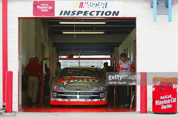 The Ganassi Racing Dodge Intrepid R/T is inspected during practice for the EA Sports 500 at Talladega Superspeedway on October 4 2002 in Talladega...