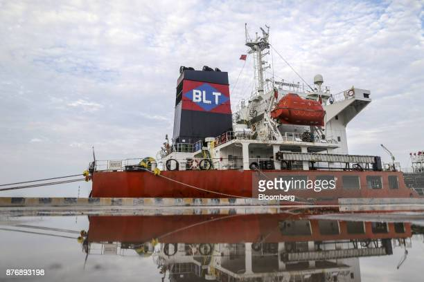 The Gandawati Tarawa tanker is reflected in a puddle while docked at Krishnapatnam Port in Krishnapatnam Andhra Pradesh India on Saturday Aug 12 2017...