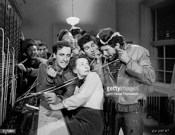 The gang intimidates the switchboard operator in a scene from 'The Wild One' directed by Laszlo Benedek