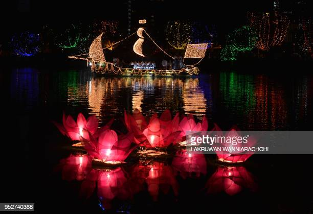 TOPSHOT The Gangaramaya Buddhist Temple is lit during the annual Buddhist festival of Vesak in Colombo on April 29 2018 Sri Lankan Buddhists are...