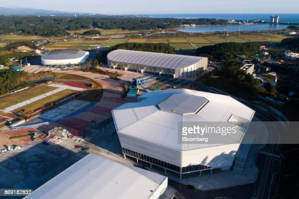 The Gangneung Hockey Center the venue for ice hockey events at the 2018 PyeongChang Winter Olympic Games right the Gangneung Oval the venue for speed...
