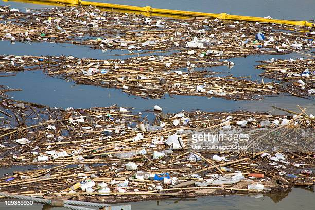 The Garbage boom on the Los Angeles River in Long Beach was built in 2001. Urban runoff carries an assortment of trash and debris from catch basins...
