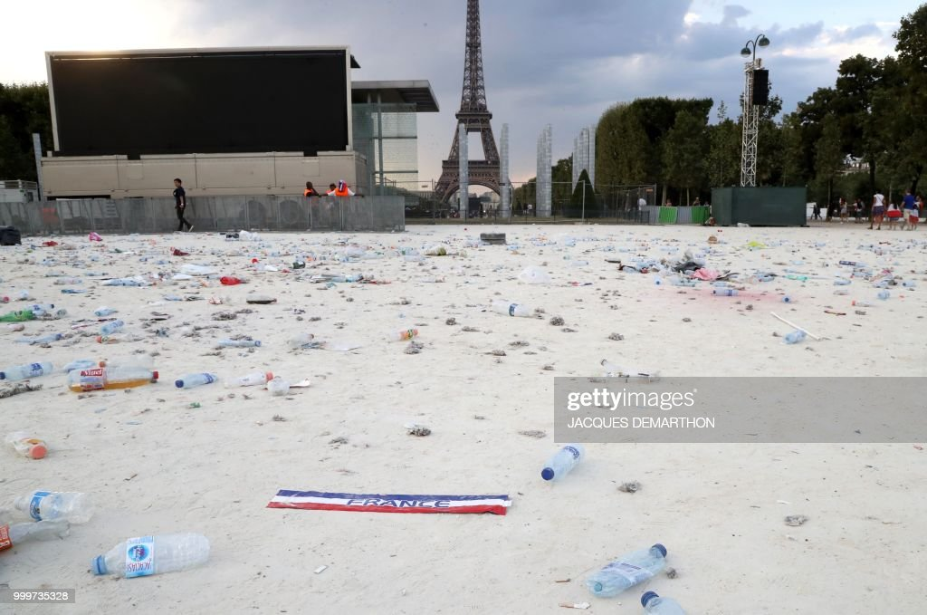 The garbage left by fans in the fan zone is pictured after the Russia 2018 World Cup final football match between France and Croatia, on the Champ de Mars in Paris on July 15, 2018.