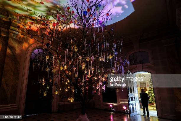 The Garden Hall is decorated with a twig tree decorated with brightly coloured Venetian Glass during a press preview of the Christmas decorations at...