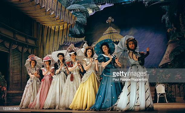 The garden party scene from a revival of Charles Cuvillier's operetta 'The Lilac Domino' at His Majesty's Theatre, London, March 1944. Original...