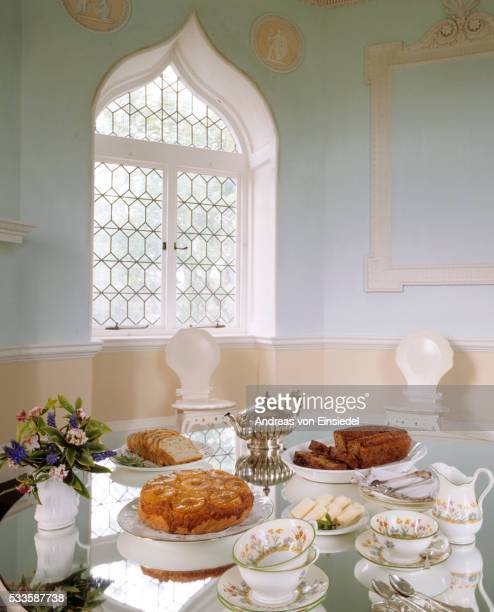The Garden Room with a variety of food and utensils laid out on the table at Saltram, Devon