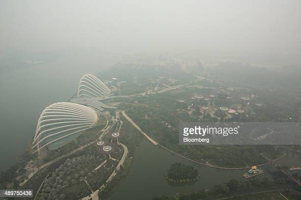 The Gardens By The Bay complex stands shrouded in smog in Singapore, on Thursday, Sept. 24, 2015. The haze from Indonesian forest fires pushed...