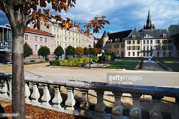 The gardens in Grenoble with the tower of St Andrew's church in the background RhoneAlps France