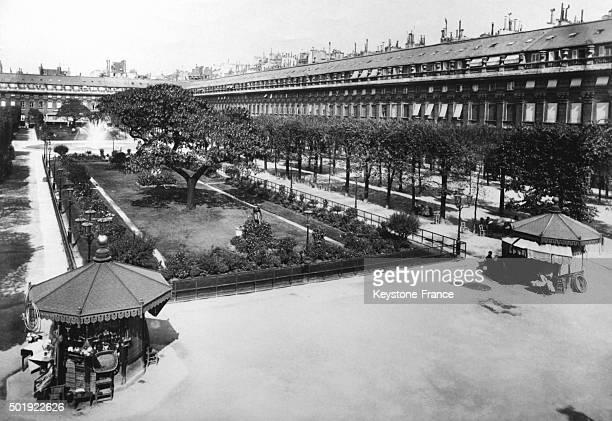 The gardens of the Palais Royal circa 1900 in Paris France