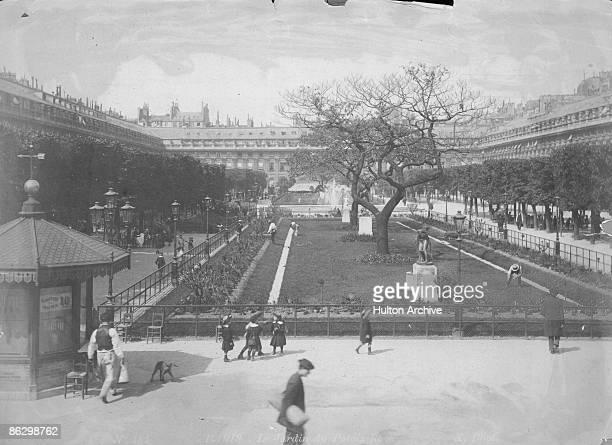 The gardens of the PalaisRoyal in Paris circa 1870