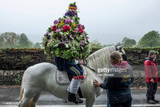 The Garland King is processed through the town during 'Castleton Garland Day' on May 29 2019 in Castleton England The first records of Garland day...