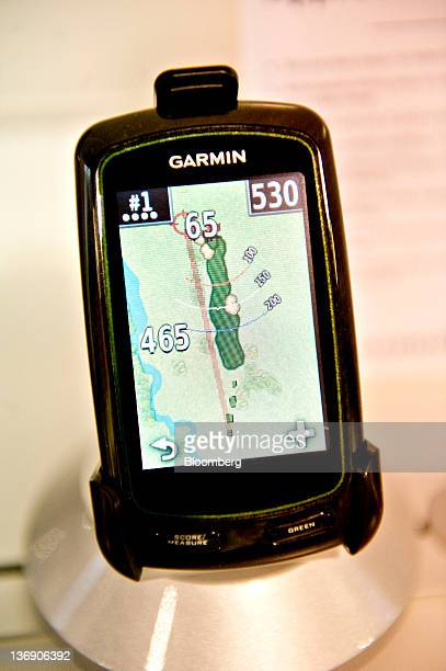 The Garmin Ltd Approach G6 a GPS unit containing an overview of approximately 25000 worldwide golf courses sits on display at the 2012 International...