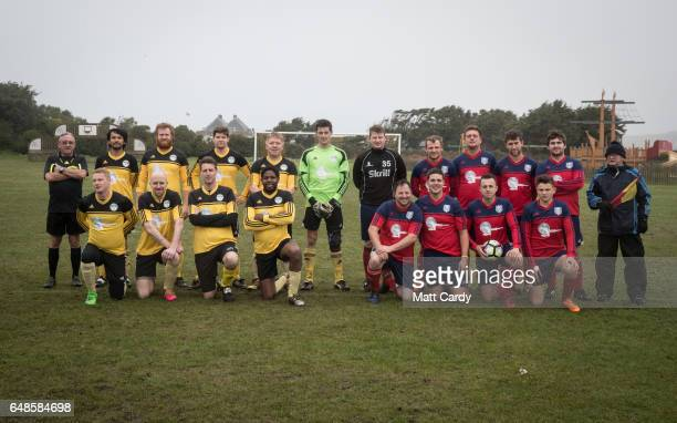 The Garrison Gunners and Woolpack Wanderers players and officials who had arrived by kickoff pose for a team picture before the game at the Garrison...