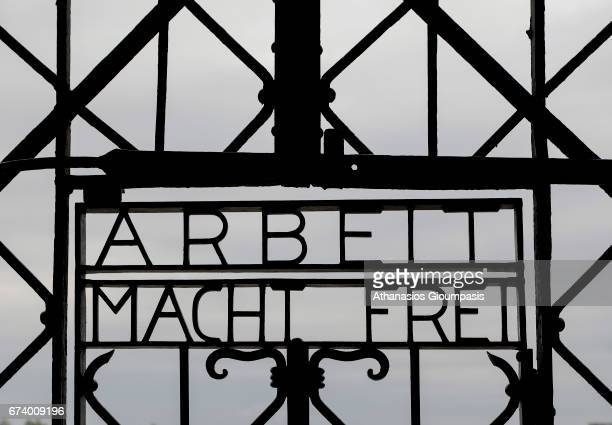 The gate at the entrance to the former Dachau concentration camp through which the prisoner's camp was entered contains the slogan Arbeit macht frei...