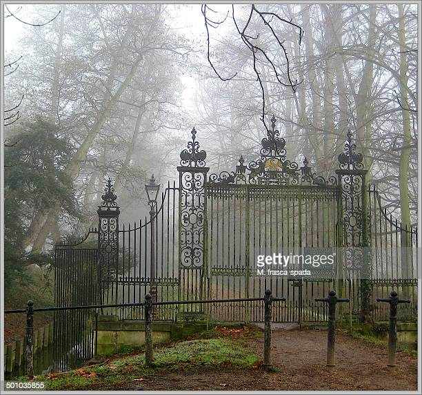 CONTENT] The gate of St John's College Cambridge on the Backs In the mist