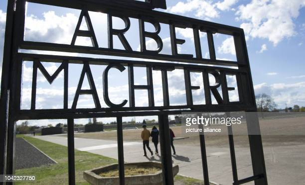 The gate reads 'Arbeit macht frei' at the former Sachsenhausen concentration camp inOranienburg Germany 17 April 2016 Many people gathered at the...