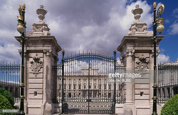 The gate that closes off the Plaza de la Armeria and the southern facade of the Royal Palace of Madrid architects Filippo Juvarra and Giovanni...