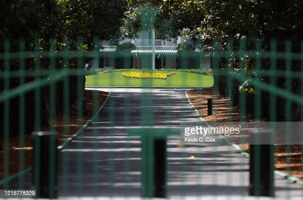 The gates are locked at the entrance of Magnolia Lane that leads to the clubhouse of Augusta National as the coronavirus pandemic causes closures of...