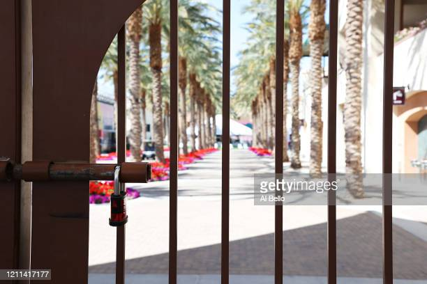 The Gates remain closed at the front entrance to the Indian Wells Tennis Garden on March 09 2020 in Indian Wells California The BNP Paribas Open was...