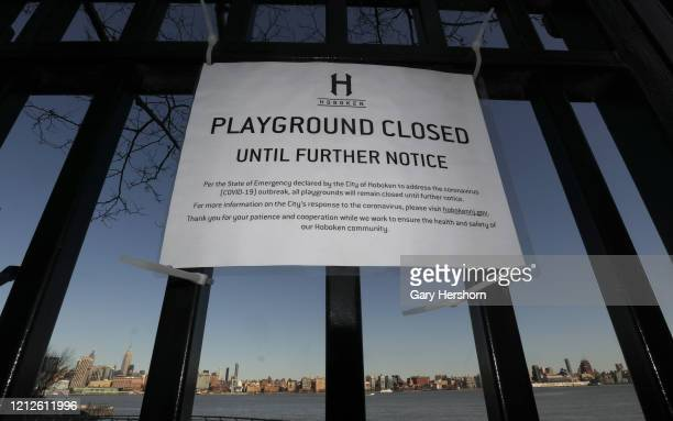 The gates to the playground on Pier C in front of the skyline of midtown Manhattan in New York City remnain locked on March 15 2020 in Hoboken New...