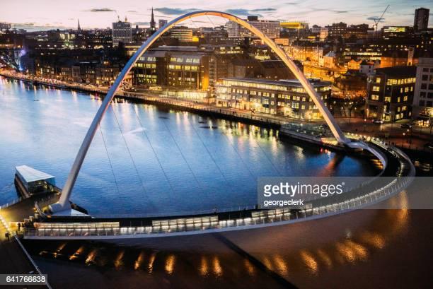 The Gateshead Millennium Bridge over the River Tyne in Newcastle, UK - high angle view